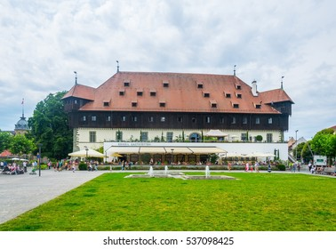 KONSTANZ, GERMANY, JULY 22, 2016: People are walking around a magnificient building of the Konzil of Konstanz in Germany.