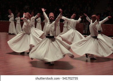 KONYA- DECEMBER 16: Sufi whirling dervish (Semazen) dances at Mevlana Culture Center on Decemmer 16, 2016 in Konya. Semazen conveys God's spiritual gift to those are witnessing the ritual.