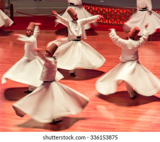 KONYA- JULY 25: Sufi whirling dervish (Semazen) dances at Mevlana Culture Center on July 25, 2015 in Konya. Semazen conveys God's spiritual gift to those are witnessing the ritual.