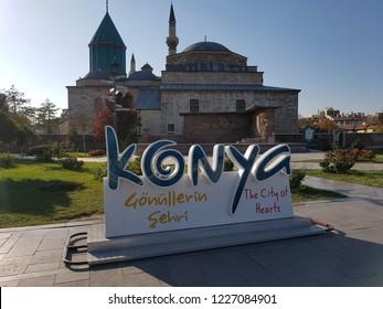 Konya Mevlana Museum. Religious building, green minaret and museum inside. Mevlana Celaleddin-i Rumi is a sufi philosopher and mystic poet of Islam. Konya - Turkey. 7 November 2018.