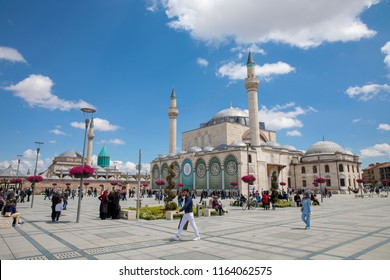 Konya, Turkey - 10 April 2016: people visit Konya Mevlana Museum from the garden of tulips and the mausoleum of Mevlana, 10 April