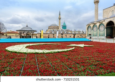 KONYA, TURKEY - 14 April 2017: Mevlana Museum from the garden of tulips and the mausoleum of Mevlana, April 14, 2017 in Konya, Turkey. Tomb of Mevlana, the founder of Mevlevi sufi dervish order.