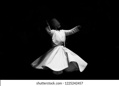 Konya, Turkey December 2018, the image of a whirling Dervish in the darkness,