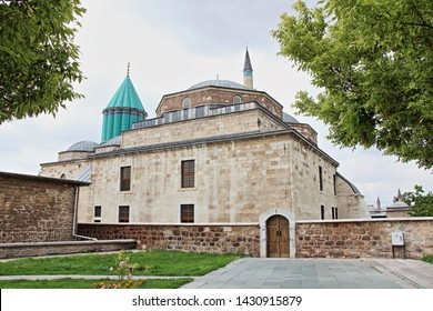 Konya / Turkey - June 20, 2019: Konya Mevlana Museum, Religious building, Green minaret and museum inside. Mevlana Celaleddin-i Rumi is a sufi philosopher and mystic poet of Islam.