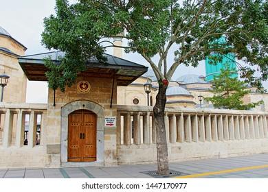 Konya / Turkey - June 20, 2019: Konya Mevlana Museum, Religious building, Green minaret and museum inside. Mevlana Celaleddin-i Rumi is a sufi philosopher and mystic poet of Islam.
