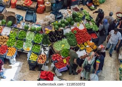 Konya, Turkey - MAY 13, 2018: Melike Hatun Bazaar (Women Bazaar) Vegetables, fruits and spices in traditional typical Turkish grocery bazaar top view. Bazaar in Konya,Turkey.