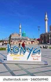 Konya / Turkey - May 14, 2019: Konya Mevlana Museum, Religious building, Green minaret and museum inside. Mevlana Celaleddin-i Rumi is a sufi philosopher and mystic poet of Islam.