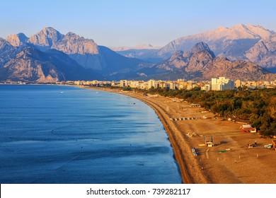 Konyaalti sand beach and Taurus mountains in the early morning light, Antalya, Turkey Mediterranean coast