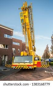Kooikerstraat 5, Alphen aan den Rijn, The Netherlands, April 24, 2019: Mobile tower crane Spierings SK377-AT3 of the company Nederhoff located in Gouda and Vianen