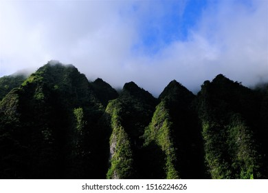 Ko'olau Mountain range along the windward side of Oahu, Hawaii.  Shots of the tops of several different ridges against blue sky, cloud sky and with clouds settled on top of the ridges.