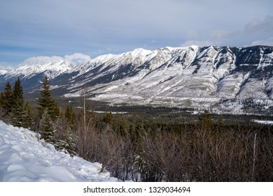 Kootenay Crossing scenic viewpoint roadside pullout in winter provides beautiful views of the Canadian Rockies
