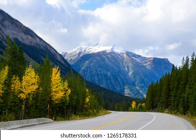 Kootenay Highway (Banff-Windermere Highway) going through Kootenay Valley and snowcapped mountain in autumn, Kootenay National Park, Canadian Rockies, British Columbia, Canada