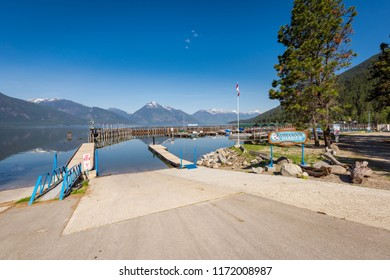 "Kootenay Lake, BC, Canada - May 14, 2018: Kuskanook Harbour is a popular and quiet ""pay per use"" harbour mainly used by recreational boaters and fishermen located on Kootenay Lake in British Columbia."