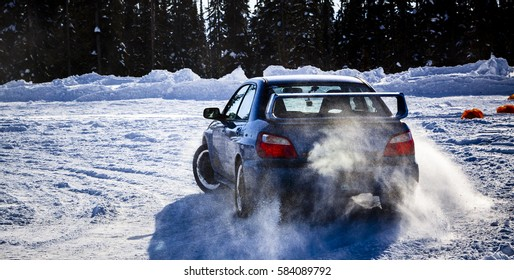 KOOTENAY MOUNTAINS BOUNDARY, CANADA - CIRCA JANUARY 2014 : 4WD Vehicle Drifting on Snowy Terrain in an editorial image