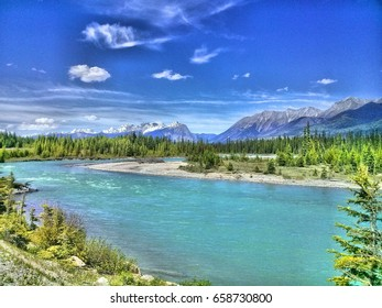 Kootenay National Park is very large with one road. On bicycle it was very long way and when I stopped I saw the river Kootenay, Mt. Hawk Ridge and very nice wild nature. It was in 35°C on July 2016.