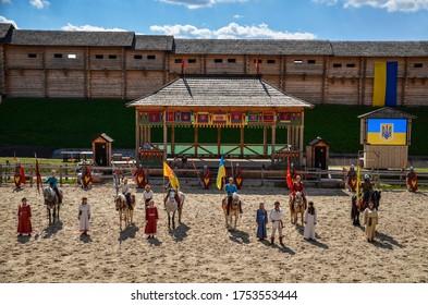 KOPACHIV, UKRAINE - 23 AUGUST 2014: Horse show perfomance at historic reconstruction festival of Medieval culture in the ethnopark Kievan Rus in the village Kopachiv, near Kyiv, Ukraine