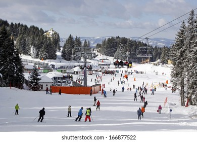 KOPAONIK, SERBIA - DECEMBER 7 2013: Skiers and snowboarders at winter resort Kopaonik in Serbia on December 7, 2013. Opening day for winter ski season 2013/2014.