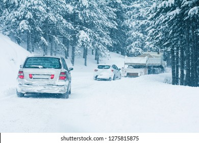 KOPAONIK, SERBIA - JANUARY 3, 2019: Heavy snow fall on road with traffic