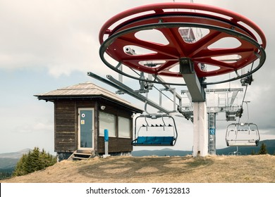 KOPAONIK, SERBIA - MAY 01, 2017: Giant pulley wheel at ski lift station with  in springtime. Chairlift wheel of the ski lift. Color effect.