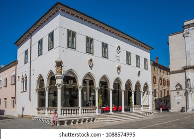 Koper, Capodistria, Slovenia - august 13, 2016: Building of the Loggia Palace in Venetian Gothic style, converted into a cafe, in the historic center of the city