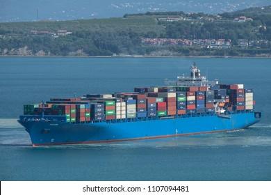 KOPER, SLOVENIA - MAY 18, 2018: Huge cargo ship manoeuvring in port of Koper