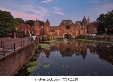 Koppelpoort, Amersfoort, the Netherlands - September 2017 : One late afternoon (Golden hour) at the Koppelpoort in Amersfoort. An old water gate and city wall from the Middle Ages