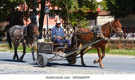 KOPRIVSHITSA BULGARIA SEPTEMBER 25 2013:  In rural Bulgaria few people in the village have cars, but some have horses and carts used for everything from hauling grass for hay, logs for heating etc,,,