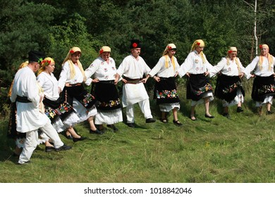Koprivshtica, Bulgaria - August 7, 2010: People in traditional folk costume of The National Folklore Fair.  The National Folklore Fair in Koprivshtica in the UNESCO list of the human cultural heritage