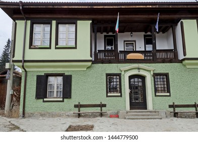 Koprivshtitsa town, Bulgaria - March 03, 2019: Authentic unique residential district with painted in bright colors houses, stone  walls, wooden windows, verandahs and picturesque eaves, Koprivshtitsa