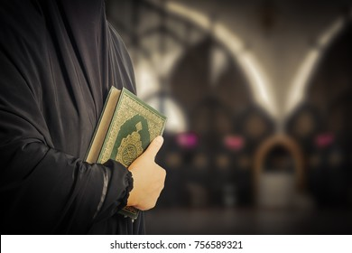 Koran in hand - holy book of Muslims( public item of all muslims )Koran in hand muslims