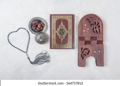 Koran - holy book of Muslims, Date-palm is placed on silver.