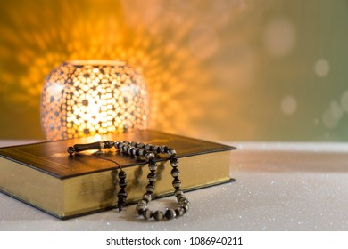 Koran - holy book of Muslims with lantern and rosary .ramadan concept.