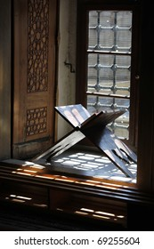 Koran on a Reading Desk