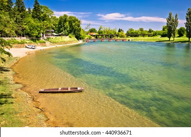 Korana river beach and wooden boat, town of Karlovac, Croatia