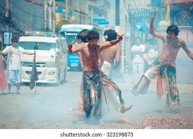 Korat, THAILAND - OCT 8: An unidentified devotee of Vegetarian Festival, person who invites the spirits of gods to possess their bodies Color Vintage on October 8, 2013 in Korat, Thailand