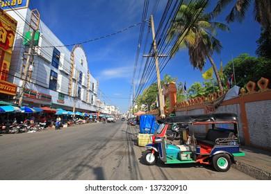 KORAT-APR 28: Motor tricycle called Tuk Tuk parking opposite local fresh market in Nakhon Ratchasima, aka Korat, Thailand on April 28, 2013. Tuk Tuk is used for transit around Korat downtown.