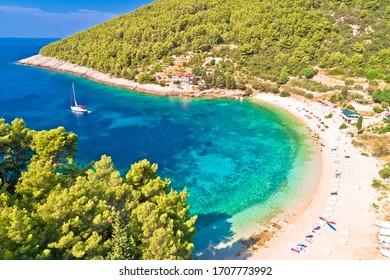 Korcula. Aerial view of Korcula island beach in Pupnatska Luka cove, southern Dalmatia archipelago of Croatia - Shutterstock ID 1707773992