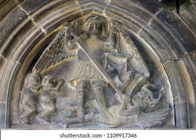 KORCULA, CROATIA - MARCH 20: Saint Michael slaying the dragon, relief in the Saint Mark Church in Korcula, Korcula island, Croatia, on March 20, 2017.