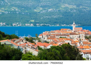 Korcula/Croatia - 05/12/2017: Aerial view at Korcula town and its terracotta roofs cityscape, mainland of Croatia, and the Adriatic sea