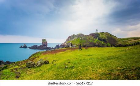 Korea, 26 April 2015 Jeju Island. Lighthouse, the target of treking in Seopjikoji. Located at the end of the Eastern shore of Jeju island, South Korea
