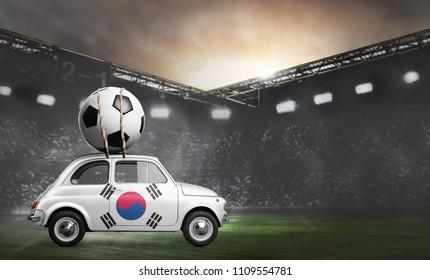 Korea flag on car delivering soccer or football ball at stadium