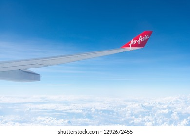 Korea - October 28, 2018::The winglet and wing of an AirAsia plane with its logo. Focus on the winglet. AirAsia has won Skytrax's 'World's Best Low-Cost Airline