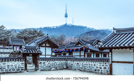 Korea Old House traditional house at winter, Namsangol Hanok Village and Seoul Tower background, Seoul, South Korea.