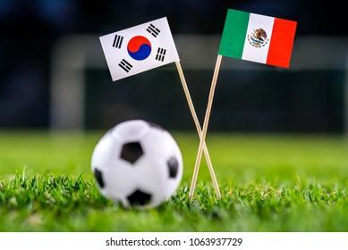 Korea Republic, South Korea - Mexico, Group F, Saturday, 23. June, Football,  National Flags on green grass, white football ball on ground.