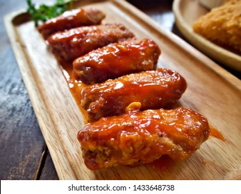 Korea style fried chicken wing on the wooden plate with decorated parsley