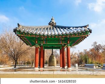 Korean architecture - a wooden gazebo in traditional Korean style with snow. Wabi sabi style Winter