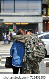 A Korean Army soldier and his girlfriend on a date at the Jeonju Hanok village on leave.