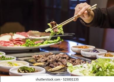 Korean BBQ Bulgogi Beef and Lettuce Held with Chopsticks