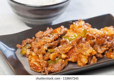 korean beef barbeque with rice cakes and rice on a side