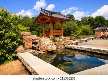 The Korean Bell Garden and water feature as seen at Meadowlark, a Northern Virginia public Regional Park for tourists and community members.